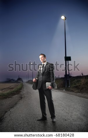 Businessman standing by night