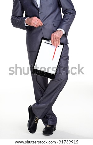 Businessman standing in a relax position holding his documents and pencile in one hand