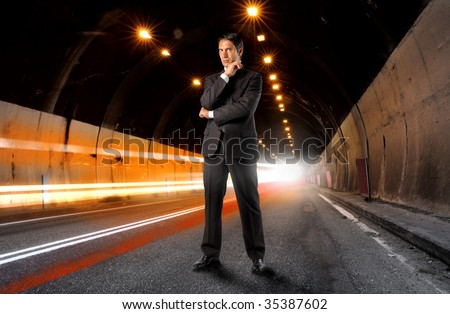 businessman standing in a tunnel