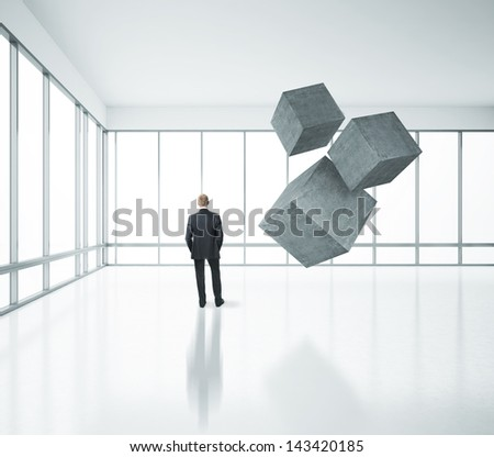 businessman standing in bright office with cubes #143420185