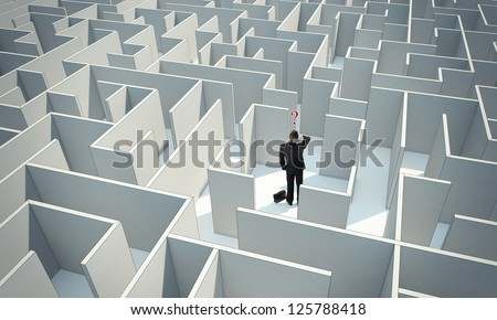 """Businessman standing in center of the maze. Make a difficult decision. Achieving the goal. Without the sign """"Welcome"""" on the wall. Wide angle. Blueprint. Encounter difficulties"""