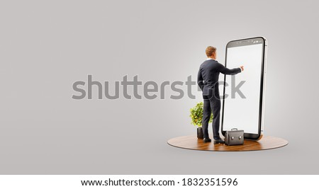 Businessman standing in front of smartphone with Stock market graph. Finance and investment Smartphone apps concept. Unusual 3d illustration