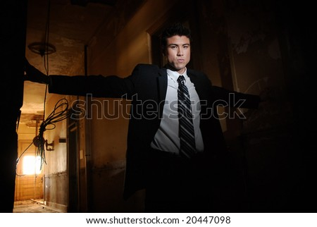 Businessman standing in hallway of a condemned building
