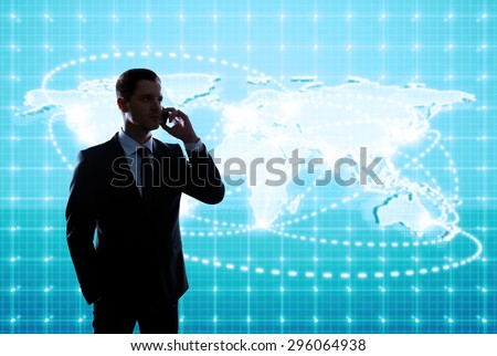 businessman standing in office with global business map