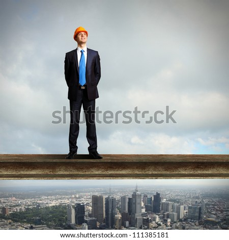 Businessman standing in suit on the construction site