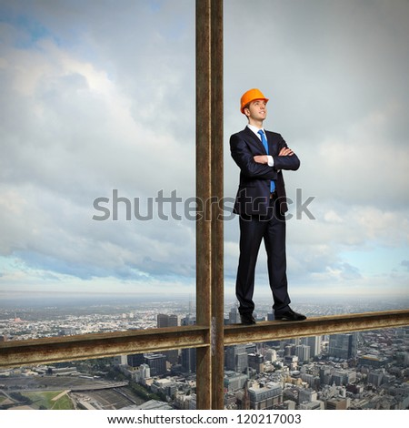 Businessman standing in suit on the construction site - stock photo
