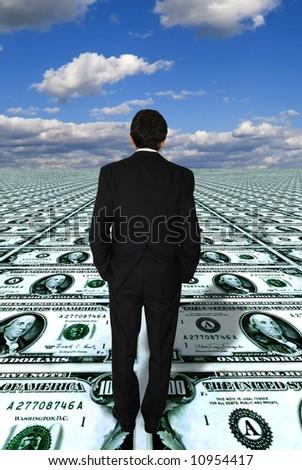 businessman standing on a dollars floor