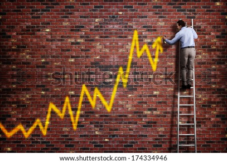 Businessman standing on a ladder and drawing a graph with positive trend in graffiti style yellow spray paint