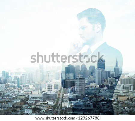 Businessman standing on background of city
