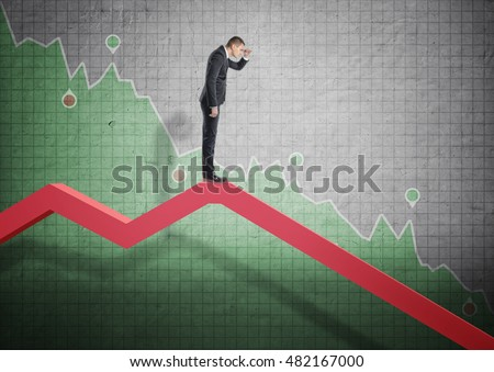 Businessman standing on falling diagram and peering into the future on the background of stock market selloff. Economic crisis. Bankruptcy and money devaluation. Stock photo ©