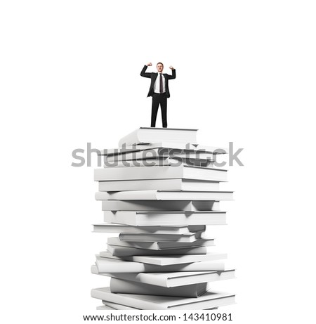 businessman standing on stack of books