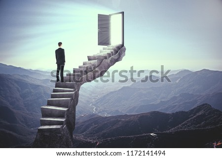 Businessman standing on stairs with abstract open door. Landscape background. Dream, exit and success concept. #1172141494