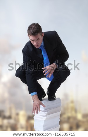 businessman standing on top of a pile of paper against a city backdrop
