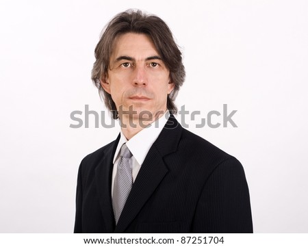 Businessman standing on white background, looking off into distance
