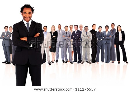 Businessman standing while smiling against a white background