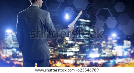 Businessman standing with back and holding contract or report in his hand #623546789