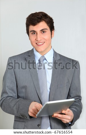 Businessman standing with electronic pad