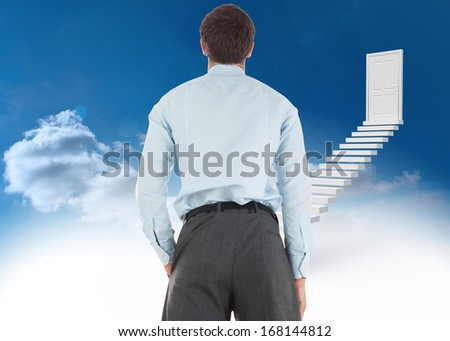 Businessman standing with hand in pocket against steps leading to closed door in the sky