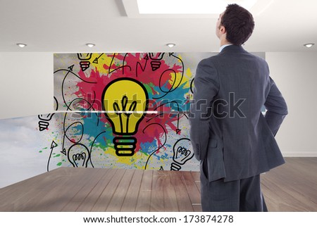 Businessman standing with hands on hips against digitally generated room with stairs