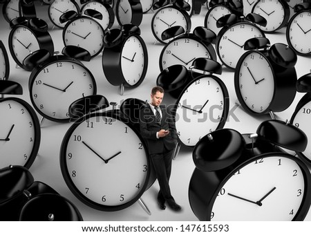 businessman standing with phone and many clock