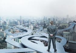 Businessman stands choosing his way