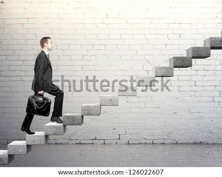 Businessman stepping up a career stair