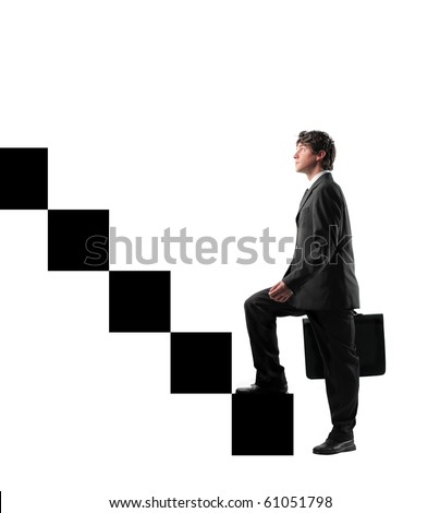 Businessman stepping up the stairs