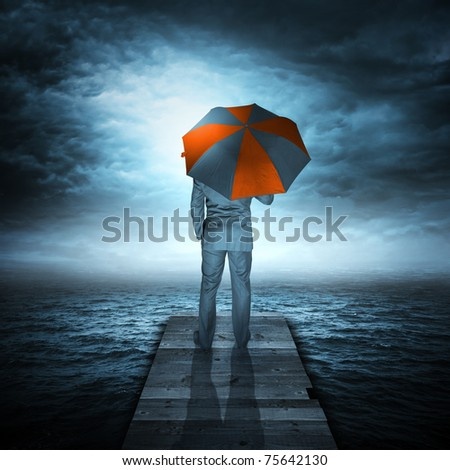 Businessman & Storm at Sea. A businessman watching an storm coming.