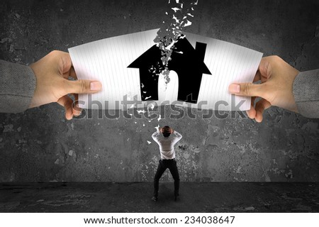 Businessman stress, ripping up a house on paper Foto d'archivio ©