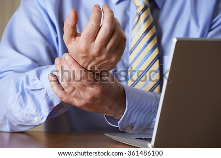 Businessman Suffering From Repetitive Strain Injury (RSI) #361486100