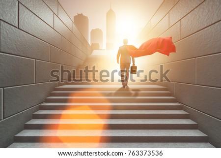 Businessman superhero successful in career ladder concept