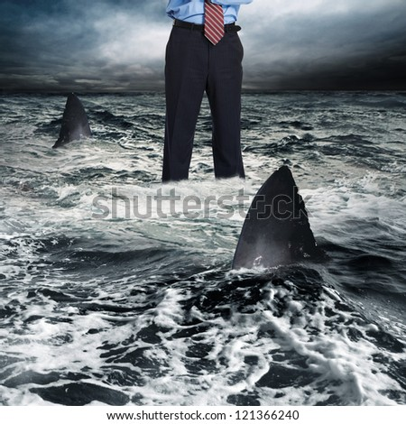 Businessman surrounded by shark