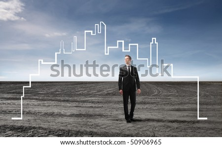 Businessman surrounded by the form of a city