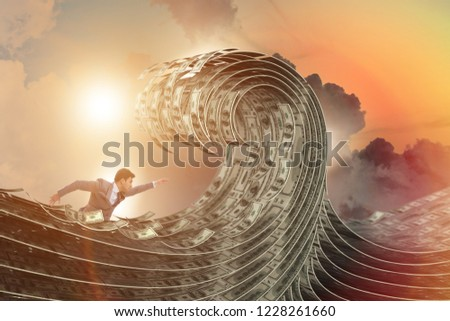Businessman swimming in the sea of dollar money