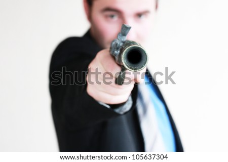 Businessman takes to gun to protect his business - stock photo