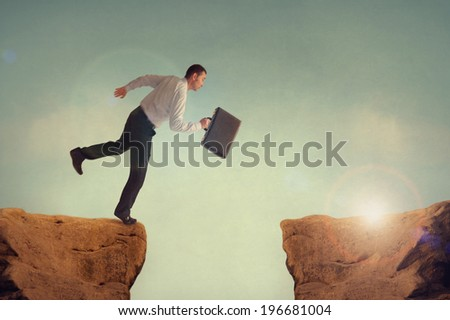 businessman taking a risk leaping to meet the challenge