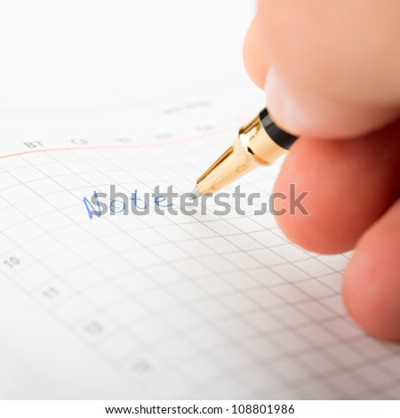Businessman taking notes and planning in a meeting
