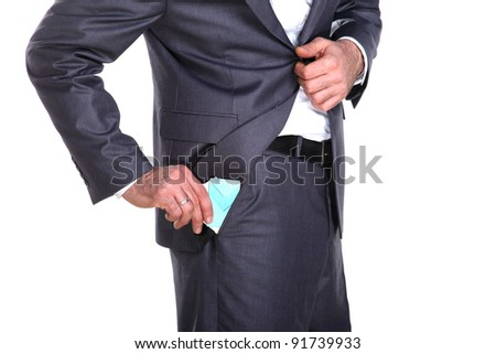 Businessman taking out credit card and some documents out in his pocket, close up