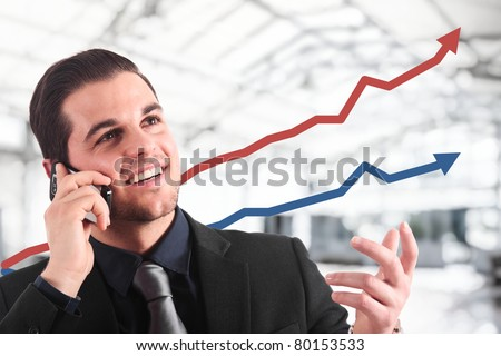 Businessman talking at the phone while the business is growing.