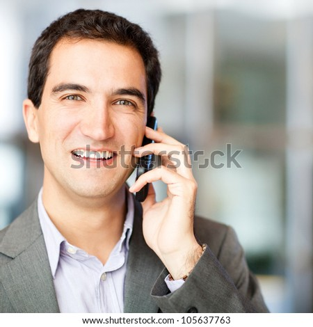 Businessman talking on his cell phone at the office