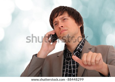 businessman talking on the phone - light business background