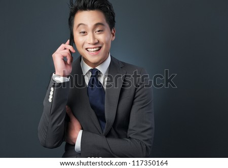 Businessman talking on the phone with happy expression
