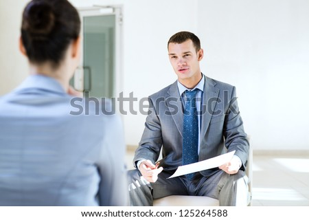 Businessman talking to a woman for a job, interviewing