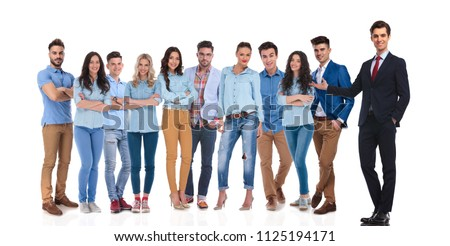 businessman team leader presenting his casual team while he is standing on the side on white background, showing them with his hand, full body #1125194171