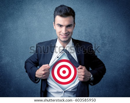 Businessman tearing his shirt off with target sign symbol on his chest concept on background #603585950