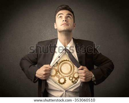 Businessman tearing shirt off and machine cog wheel shows on his chest concept on background Сток-фото ©
