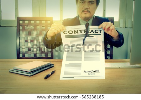 businessman tearing The Contract. unacceptable concept. color tone.