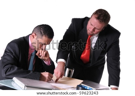 businessman telling his employee where to sign