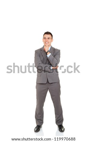 Businessman think pondering look up to empty copy space, Handsome young business man happy smile have idea, hold hand finger on chin full length portrait isolated over white background