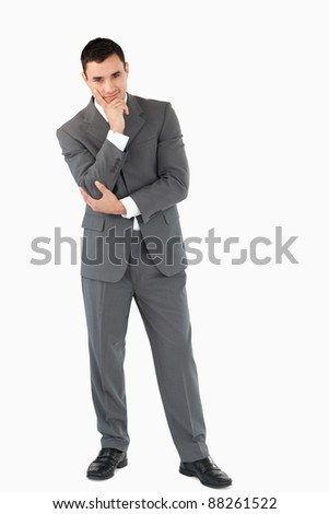 Businessman thinking about something against a white background